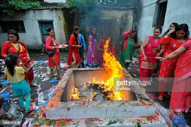 Nepalese Hindu devotees offering oil and butter lamps at the Rishishwor Mahadev Temple during Rishi Panchami Festival celebrations at Teku Katmandu...