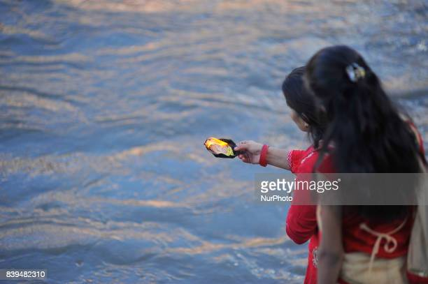 Nepalese hindu devotees offering oil lamps at the Rishishwor Mahadev Temple during Rishi Panchami Festival celebrations at Pashupatinath Temple...