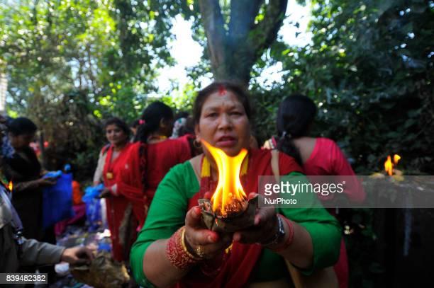 Nepalese hindu devotees offering oil lamps at the Rishishwor Mahadev Temple during Rishi Panchami Festival celebrations at Teku Katmandu Nepal on...