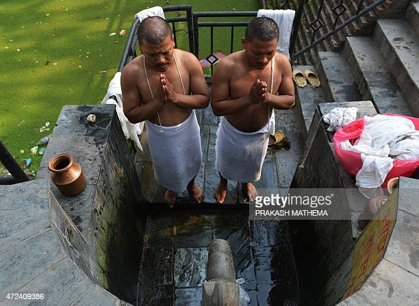 Nepalese Hindu devotees perform a mourning ritual at the Pashupatinath temple in Kathmandu on May 7, 2015. The 7.8 magnitude earthquake which struck...