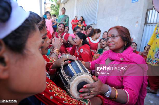 Nepalese hindu devotees playing drums and dancing at the Rishishwor Mahadev Temple during Rishi Panchami Festival celebrations at Teku Katmandu Nepal...