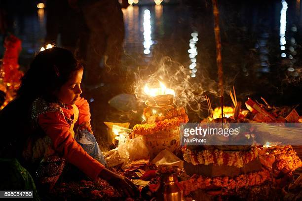 Nepalese Hindu devotees pray to the setting sun sitting near the Ranipokhari pond during the Chhath festival in Kathmandu Nepal 17 November 2015 The...
