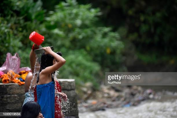 Nepalese Hindu girls performing rituals at the Bagmati River of Pashupatinath Temple during Rishi Panchami Festival celebrations at Pashupatinath...