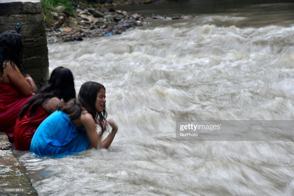 Nepalese Hindu girls takes a ritual bath at the Bagmati River of Pashupatinath Temple during Rishi Panchami Festival celebrations at Pashupatinath Temple, Katmandu, Nepal on Friday, September 14, 2018. Rishi Panchami festival is celebrated as the last day of three-day long Teej Festival. The Teej festival is celebrated by Hindu women in Nepal as well as in some parts of India. During the three-day long festival, women observe a day-long fast and pray for the long life their husbands as well as for a happy family. Those who are unmarried pray for a good husband and a long life.