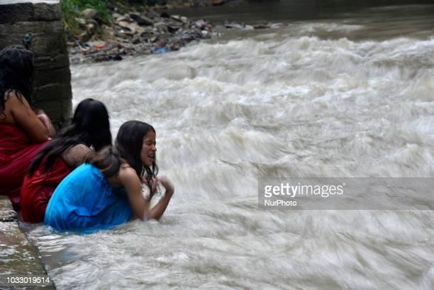 Nepalese Hindu girls takes a ritual bath at the Bagmati River of Pashupatinath Temple during Rishi Panchami Festival celebrations at Pashupatinath...