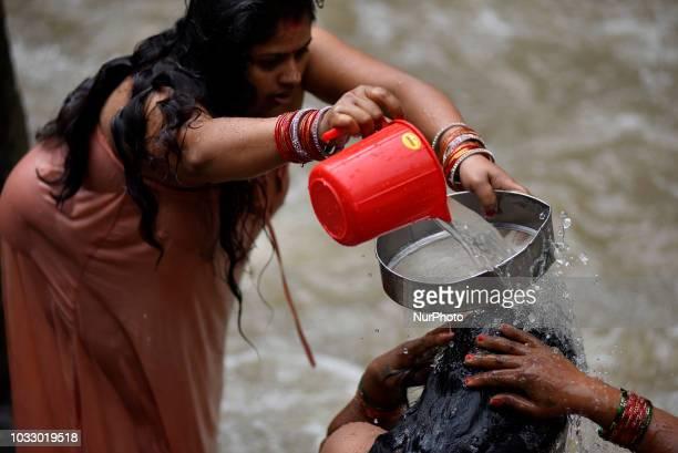 Nepalese Hindu woman takes a ritual bath at the Bagmati River of Pashupatinath Temple during Rishi Panchami Festival celebrations at Pashupatinath...
