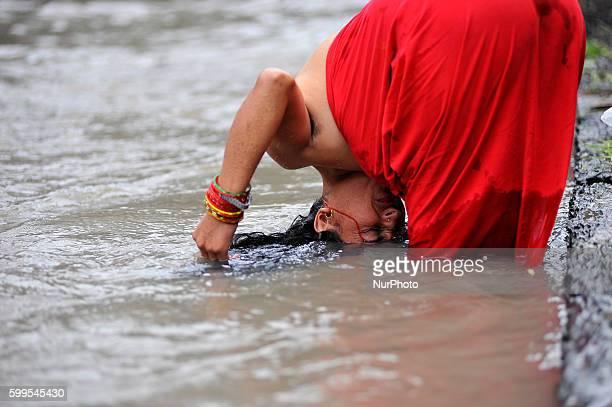A Nepalese Hindu woman takes a ritual bath at the Bagmati River of Pashupatinath Temple during Rishi Panchami Festival celebrations at Pashupatinath...
