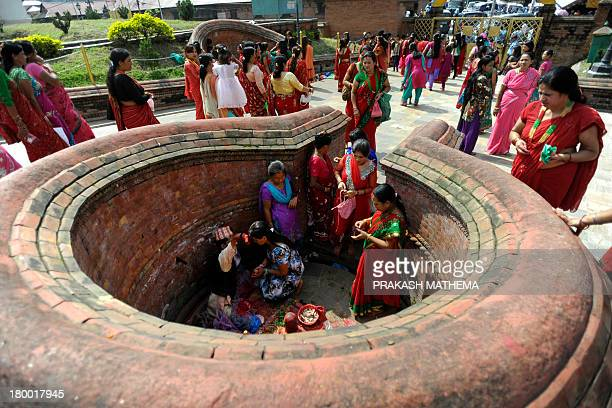 Nepalese Hindu women dressed in red gather to pay homage to Shiva the Hindu god of destruction as they celebrate the Teej festival at the...
