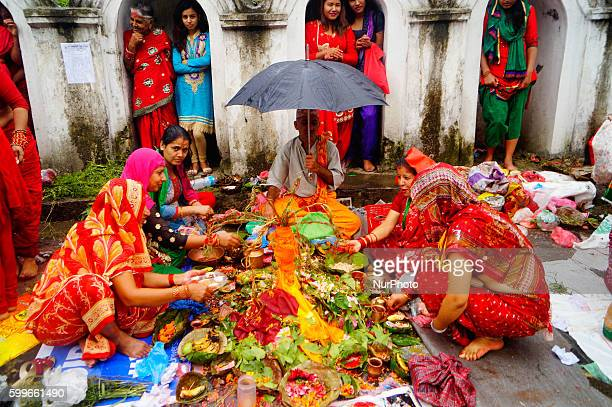 Nepalese Hindu women perform ritual at the bank of Bagmati River during the Rishi Panchami festival in Kathmandu Nepal September 6 2016 Rishi Pancham...