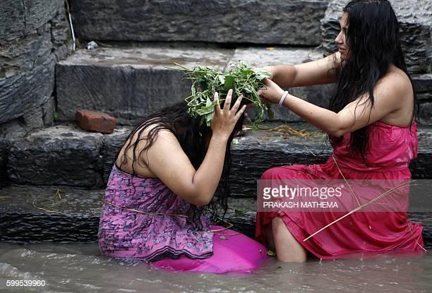 Nepalese Hindu women take a ritual bath in the Bagmati river during 'Rishi Panchami' in Kathmandu early on September 6 2016 Rishi Panchami marks the...