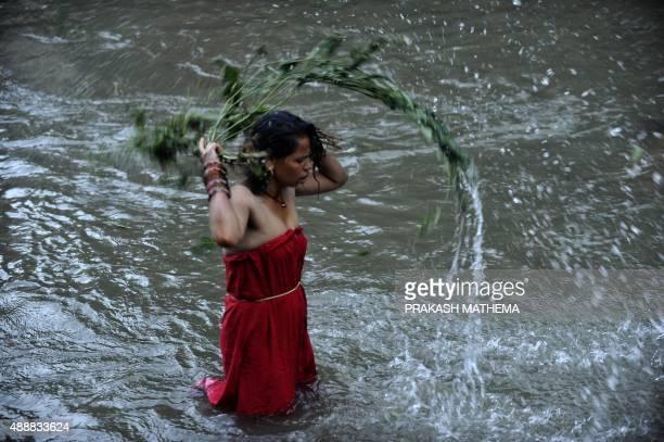 A Nepalese Hindu women takes a ritual bath in the Bagmati river during 'Rishi Panchami' in Kathmandu early on September 18 2015 Rishi Panchami marks...