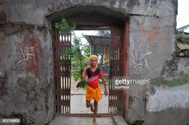 A Nepalese kid from Hindu school Bhagwat Sanyaas Aashram Gurukul prepare for rituals offering during Nag Panchami festival at Pashupatinath Temple...