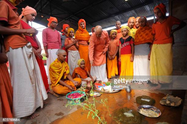 Nepalese kids from Hindu school Bhagwat Sanyaas Aashram Gurukul performing rituals offering during Nag Panchami festival at Pashupatinath Temple...