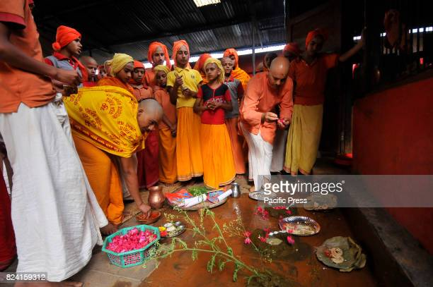Nepalese kids from Hindu school Bhagwat Sanyaas Aashram Gurukul performing rituals offering during Janai Purnima festival or Rakchhya Bandhan at...