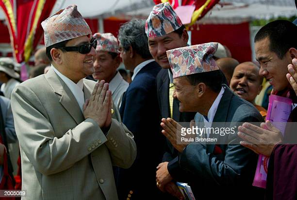 Nepalese King Gyanendra greets officials at the Lumbini Day celebrations honoring the reopening of the restored Mayadevi Temple on the Buddha Jayanti...