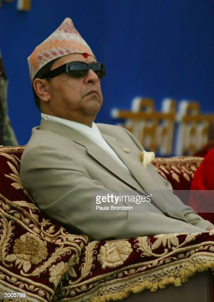 Nepalese King Gyanendra listens to officials at the Lumbini Day celebration honoring the reopening of the restored Mayadevi on the occasion of the...