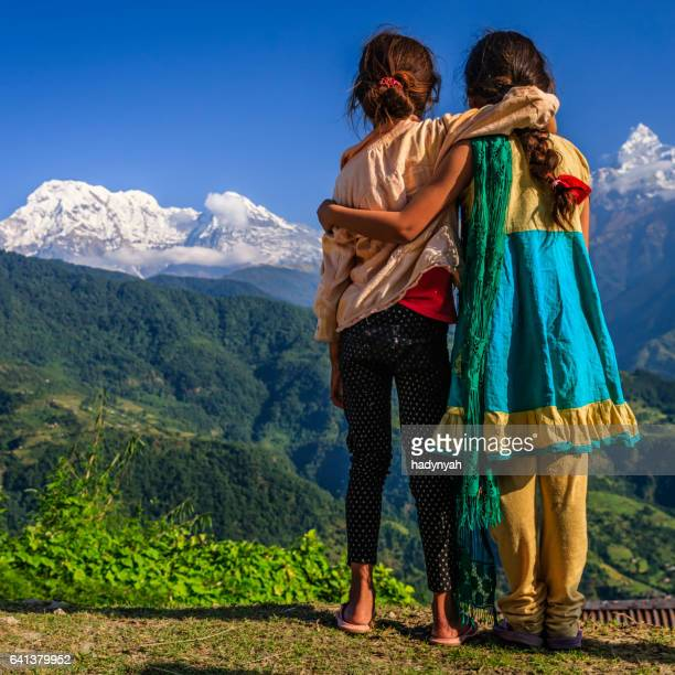 Nepalese little girls looking at Annapurna South