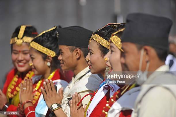 KATHMANDU NEPAL KATHMANDU NE NEPAL Nepalese Magar community people in a traditional attire welcomes during prade of the Maghi festival celebrations...