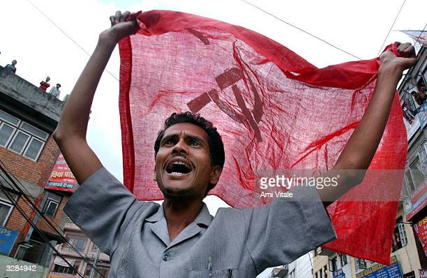 Nepalese man holds a flag during protests against King Gyanendra April 9, 2004 in Kathmandu, Nepal. The five-party opposition alliance said 2,500...