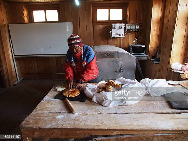 Nepalese man makes bread and cheese high in the Langtang Valley. The cheese is made from yak milk, and the high altitude of 3800 meters makes baking...