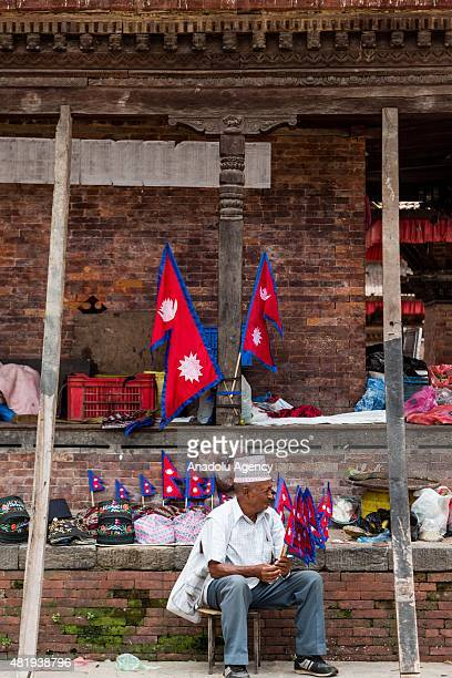 Nepalese man sells flags of Nepal at the site of Durbar square in Kathmandu on July 25, 2015. Today marks the 3 month anniversary of the Nepal...