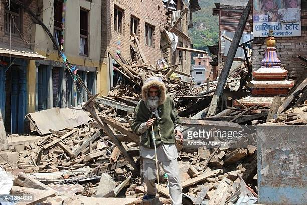 Nepalese man walks among the destroyed buildings after a powerful earthquake hits Katmandu Nepal on April 27 2015 The death toll in Nepal following...