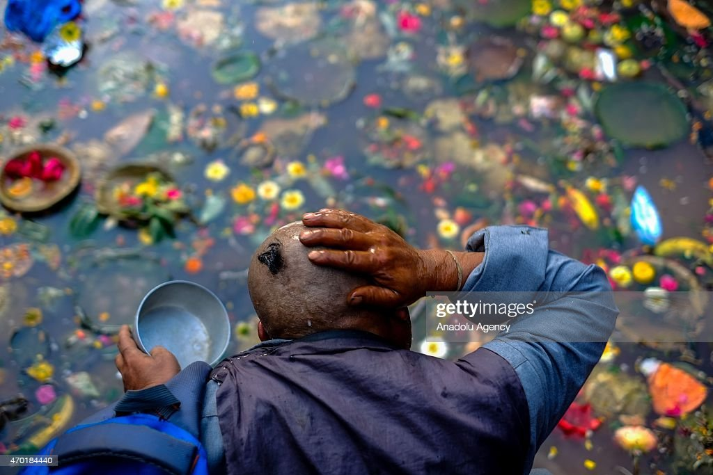 A Nepalese man washes his head before performing ruitals at Matatritha during the Matatritha Aunsi or Mothers Day in Kathmandu, Nepal on April 18, 2015. Nepalese whose mothers have passed away, take a holy dip to honour their soul at the sacred Matatritha shrine, give offerings to priests to commemorate the departed and others observe Mothers Day by presenting sweets and gifts to their mothers.