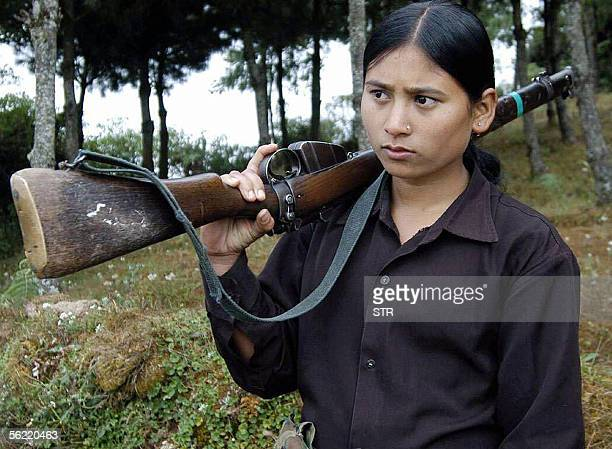 Nepalese Maoist guerrilla woman holds a rifle during an armed exercise in Bhojpur eastern Nepal 08 November 2005 Nepal's Maoist rebels announced a...