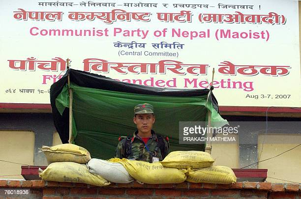 A Nepalese Maoist soldier stands in front of the entrance to a meeting of the top leaders of the Communist Party of Nepal in Kathmandu 08 August 2007...