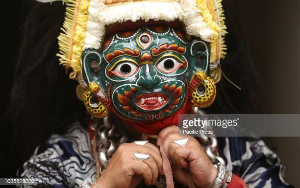 Nepalese masked dancer gets ready to perform Devi dance prior of Indrajatra festival in KathmanduNepal People worship Indraking of gods during the...