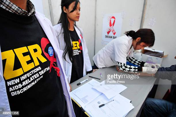 Nepalese medical representative taking blood for Rapid HIV testing jointly organized by National Centre for AIDS and STD Control during the 28th...