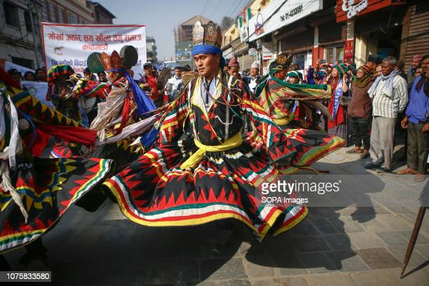 Nepalese men from ethnic Gurung community in traditional attire dance as they take part in parade to mark their New Year also known as Tamu Losar The...
