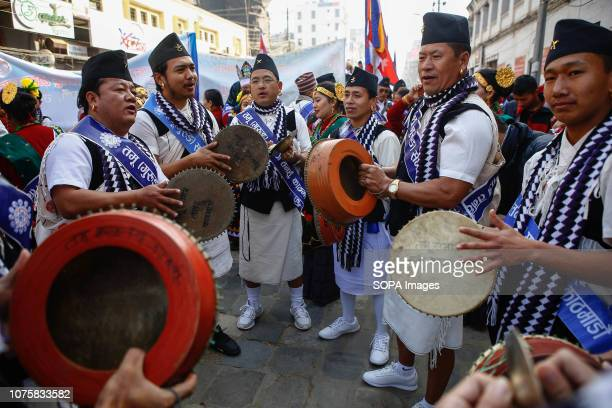 Nepalese men from ethnic Gurung community in traditional attire play traditional drum as they take part in parade to mark their New Year also known...