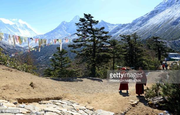 Nepalese monks walk towards the cremation site of Swiss climber Ueli Steck at Tengboche some 300 kms northeast of Kathmandu on May 4 2017 The body of...