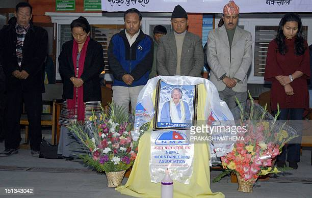 Nepalese mountaineer and tentime everest summiteer Ang Rita Sherpa stands along with others as they mourn the death of Sir Edmund Hillary in...