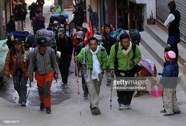 Nepalese mountaineer Apa Sherpa who has scaled Everest a recordbreaking 21 times walks with his team members in Sindhpalchowk some 100 kilometres...