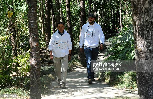 Nepalese mountaineer Apa Sherpa who has scaled Mount Everest a recordbreaking 21 times takes a stroll with Dawa Steven Sherpa in Sindhpalchowk some...