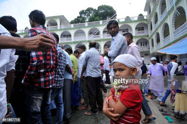 A Nepalese Muslim kid awaits as his father wash his hands face and feet before praying during celebration of Bakra Eid or Eid alAdha or IdulAzha on...