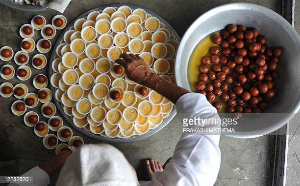 Nepalese Muslim men prepares food to break the fast after the JummatUlVida the last Friday prayers ahead of the Eid alFitr festival during the month...