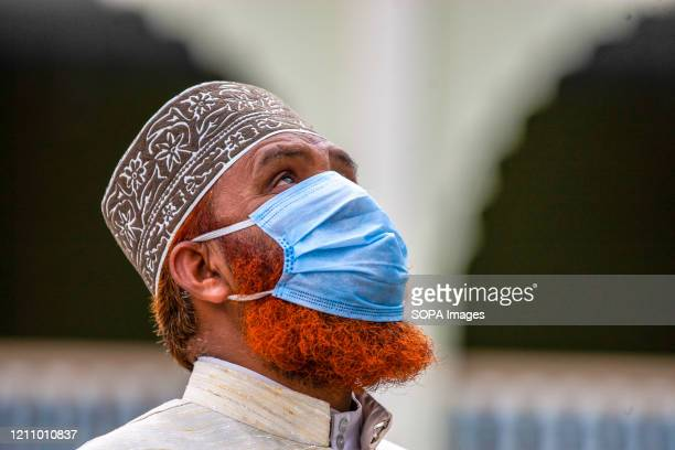 Nepalese Muslim offers prayers at the Kashmeeree jaama masjid while wearing a face mask as a preventive measure on the first day of Ramadan during...