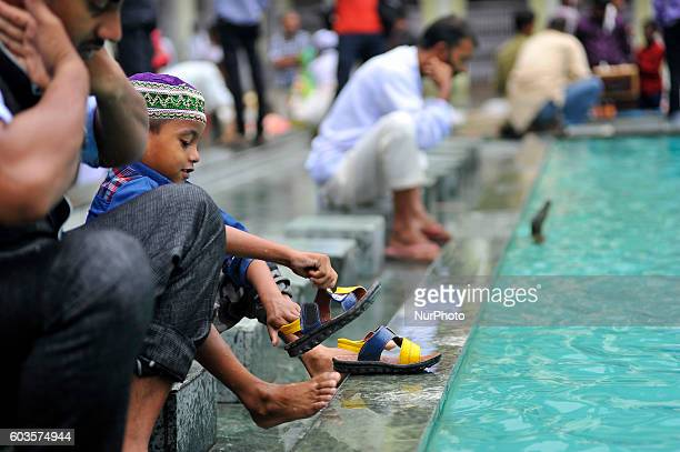 A Nepalese Muslim wash his hands face and feet before praying during celebration of Bakra Eid or Eid alAdha or IdulAzha on Tuesday September 13 2016...