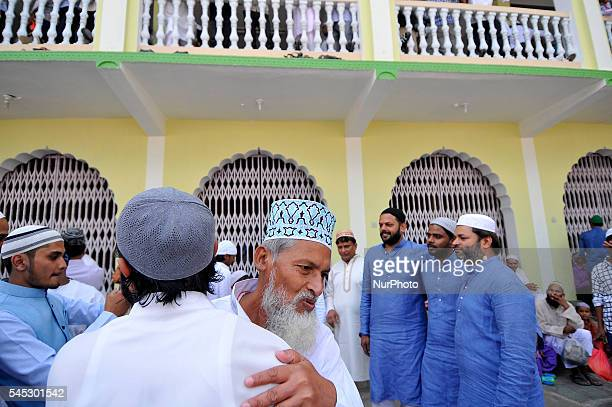 Nepalese Muslims hug each other after offering ritual morning prayers during celebration of Eid alFitr on July 7 2016 in Kashmire Jame Mosques...