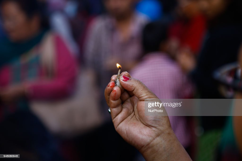 Nepalese offer oil lamp at the temple on Nepali New year Day in Kathmandu, Nepal, April 14, 2018.