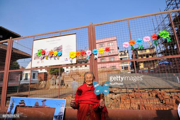 A Nepalese oldwomen hold placards to take picture on a photo booth on a 'Ride Against Cancer' is an annual event organized by Richa Bajimaya Memorial...
