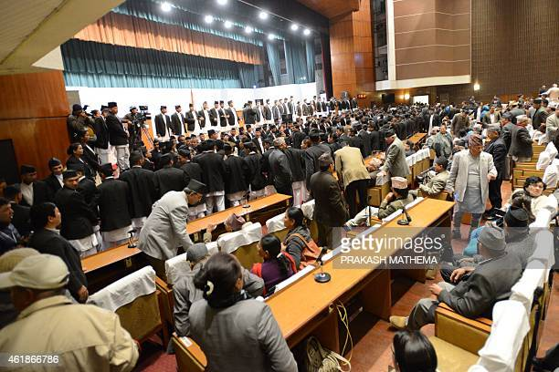 Nepalese opposition lawmakers are held back by parliament security officials as they chant slogans and obstruct the meeting of Nepal's constituent...