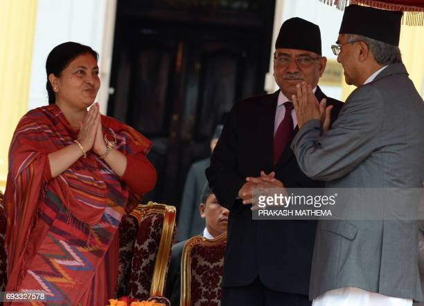 Nepalese outgoing prime minister Pushpa Kamal Dahal introduces Nepal's newlyelected Prime Minister Sher Bahadur Deuba to Nepalese President Bidhya...