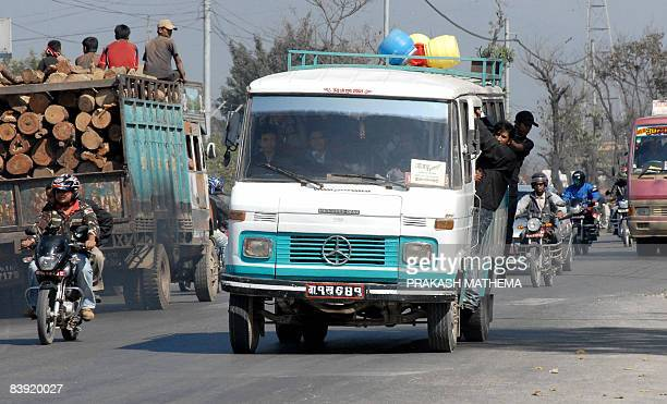 STORY 'LIFESTYLENEPALTRANSPORT' BY DEEPESH SHRESTHA Nepalese passengers ride on a Mercedes Benz bus along a street in Kathmandu on November 11 2008...