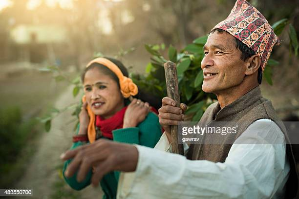 nepalese peasant couple standing outdoor together in their traditional dress. - nepalese ethnicity stock pictures, royalty-free photos & images
