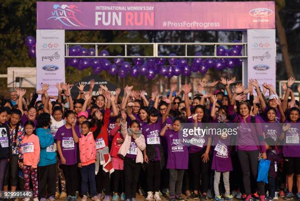 Nepalese people and foreigners cheer themselves before running on an International Women's Day 5K Fun Run at Patan Nepal on Saturday March 10 2018...