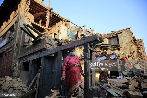 Nepalese people are seen among the debris of buildings in the Bhaktapur city 20km from the capital Kathmandu Nepal on May 5 2015 after the...